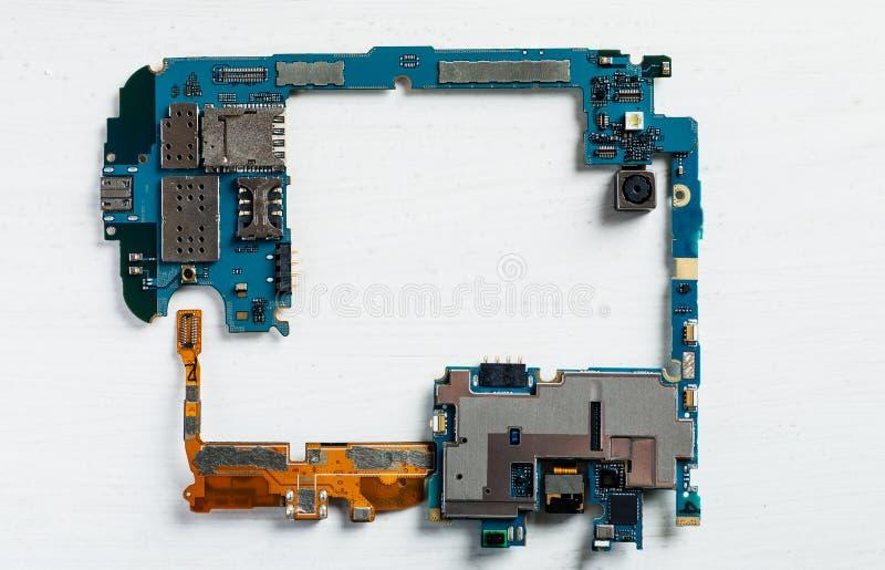 Quadro feito das peças internas dos telefones celulares imagem de stock royalty free