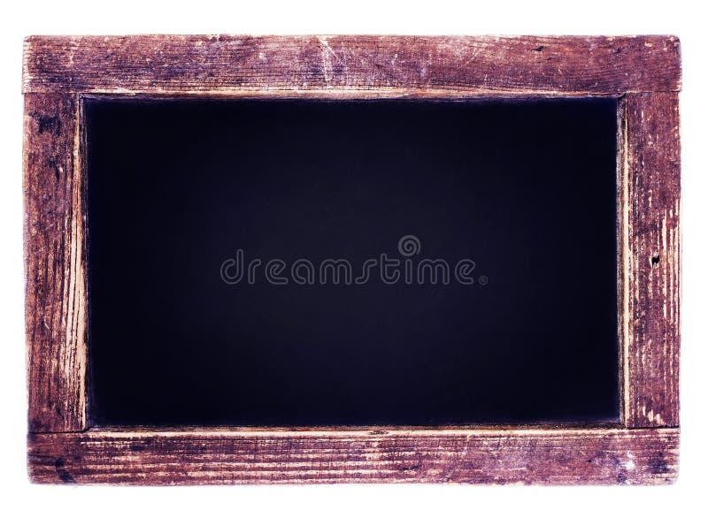 Quadro-negro do vintage no fundo de madeira. Placa de giz vazia com foto de stock