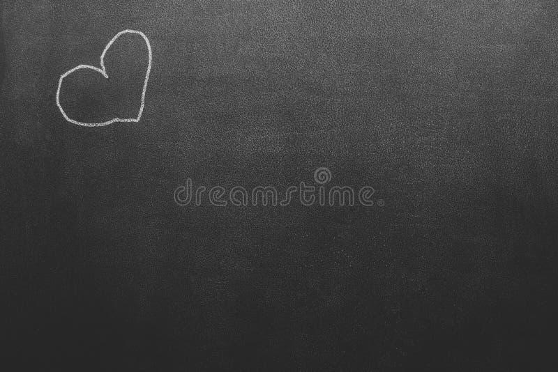 Quadro preto com desenho de uma textura do fundo do symbole do coração imagem de stock royalty free