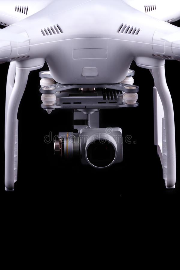 Quadrocopter, copter, drone. Unmanned aerial vehicle, drone on isolated background, quadrocopter designed for photo and video shooting. White quadrocopter camera stock images