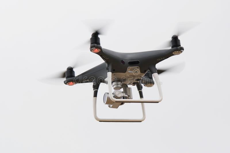 Quadrocopter in the sky royalty free stock photography