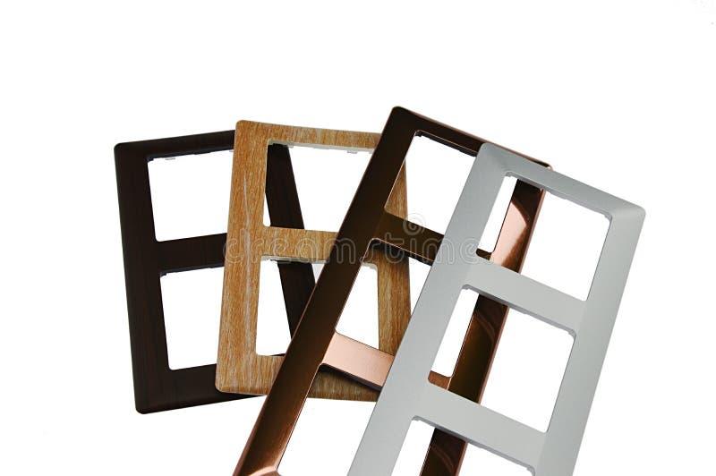 Quadros de interruptor da luz com materiais da imitação do projeto vários tais como a madeira, o cobre e o alumínio, fundo branco imagens de stock