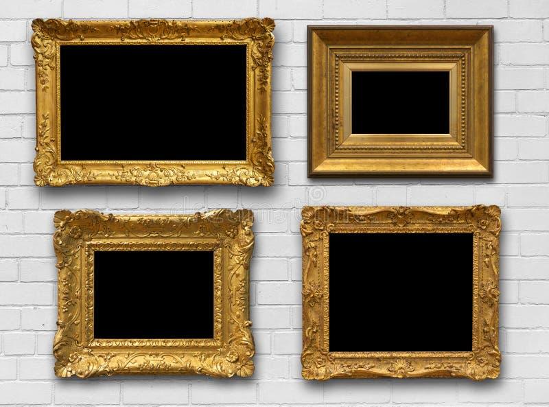 Quadros do ouro na parede imagens de stock