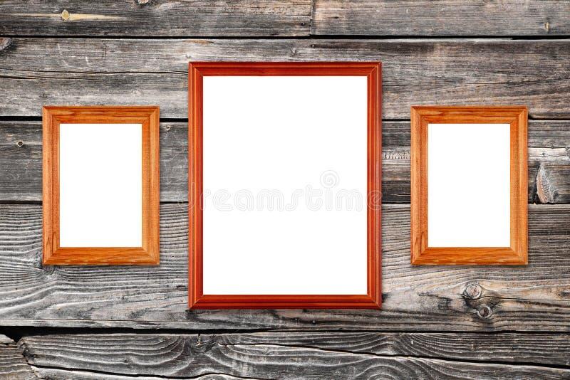 Quadros vazios da foto na parede de madeira fotos de stock royalty free