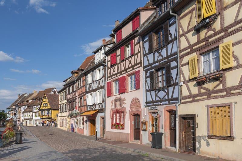 Half timbered houses at Quai de la Poissonnerie street, Little Venice Colmar, Alsace France. stock photos