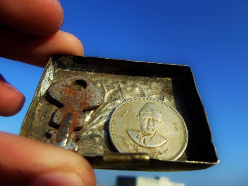 Quaid-e-Azam`s 50 Paisa Coin and a key stock image