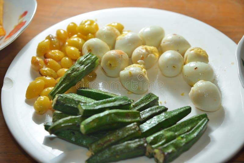 Quail Eggs Okra veggie. Thai Quail Eggs Okra veggie platter royalty free stock photos