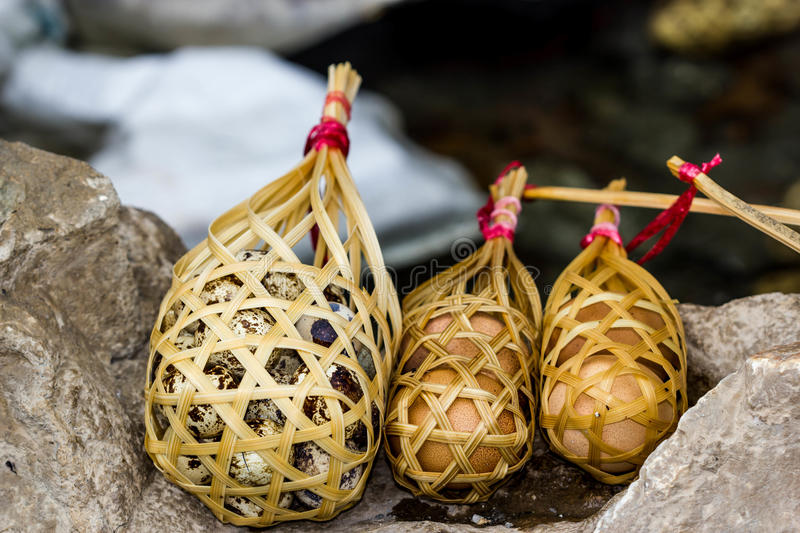 Quail eggs in round bamboo basket boil on hot spring. Quail eggs and eggs in round bamboo basket boil on hot spring stock images