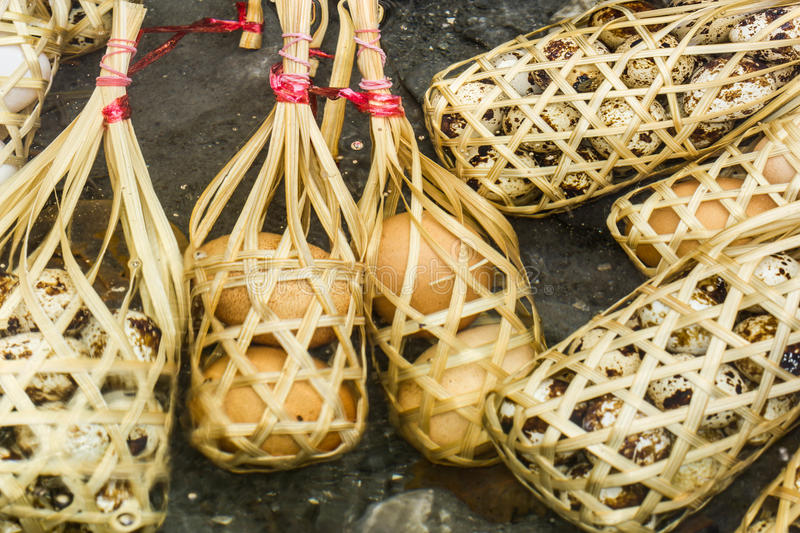 Quail eggs in round bamboo basket boil on hot spring. Quail eggs and eggs in round bamboo basket boil on hot spring royalty free stock photos