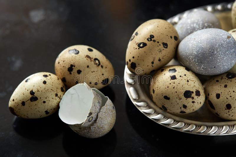 Quail eggs in vintage silver plate stock image