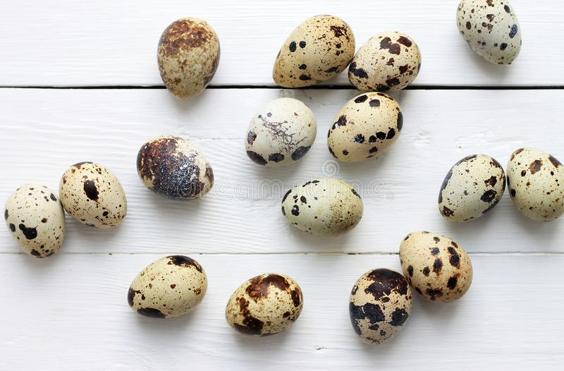 Quail eggs on a wooden boards. Easter holiday background. Quail eggs on a light wooden boards. Easter holiday background stock images