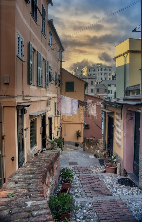 Quaint narrow street in Boccadasse at sunset royalty free stock photos
