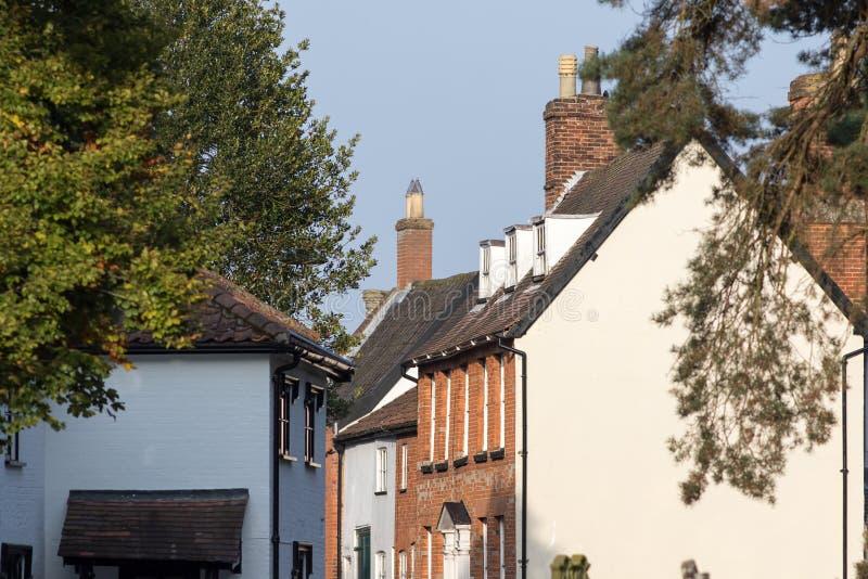 Quaint old English village street houses. Wymondham town Norfolk royalty free stock photography
