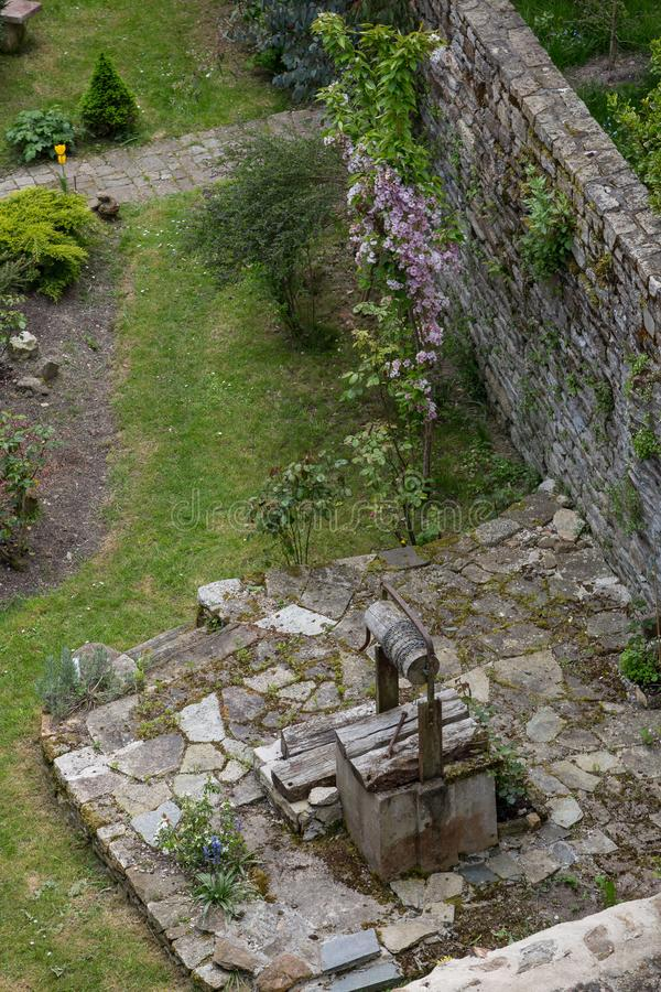 Quaint old garden well, Dinan, Brittany stock photography
