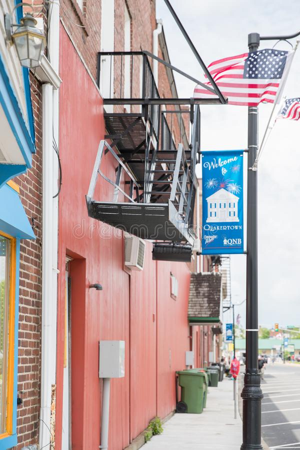 A photo of a typical small town main street in the United States of America. Quakertown, Pennsylvania - May 19, 2018: A photo of a typical small town main royalty free stock image