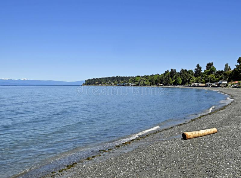 Qualicum Beach, Vancouver Island. View over the Georgia Strait from Qualicum Beach on a sunny day with blue sky, Vancouver Island British Columbia Canada stock image