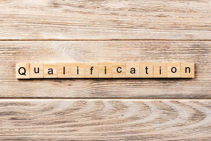 Qualification word written on wood block. qualification text on table, concept.  stock photography
