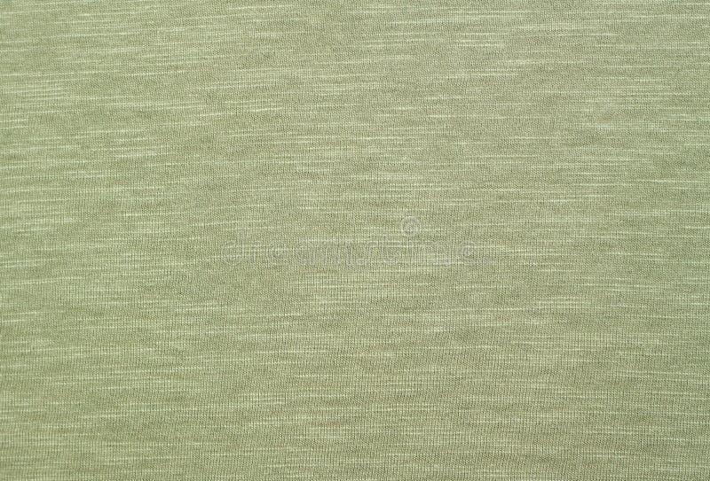 Qualitative green melange texture on eco-cotton linen. Environmentally friendly handmade material royalty free stock photo