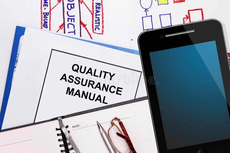 Quality assurance manual. Business graphs and business plan royalty free stock photos