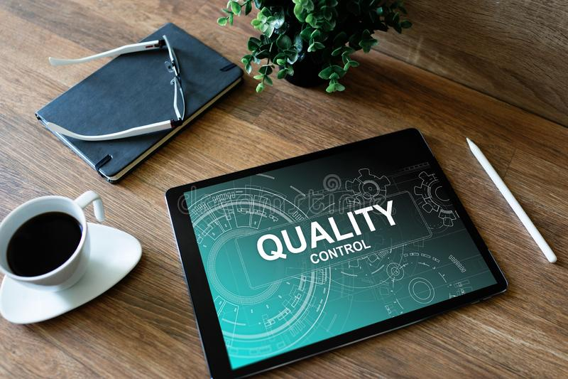Quality control concept on device screen. Business and technology concept. Quality control concept on device screen. Business and technology concept stock photography