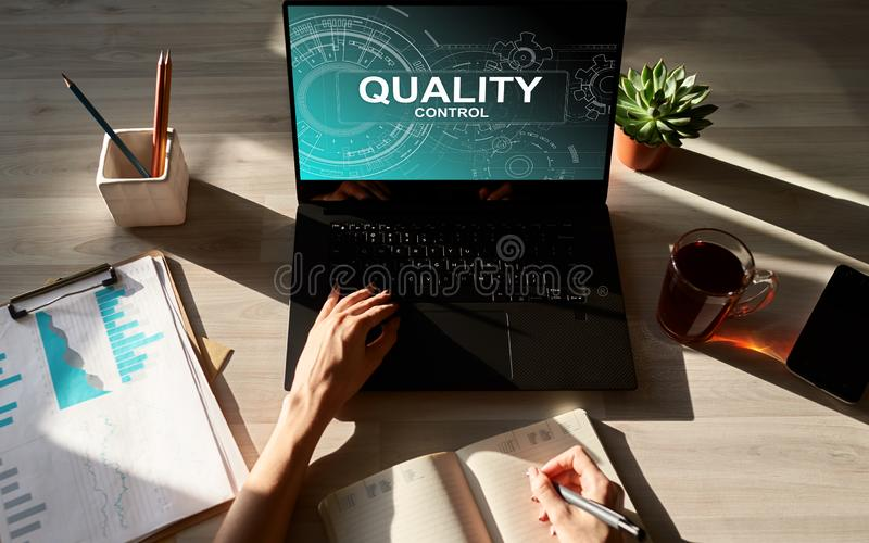 Quality control concept on device screen. Business and technology concept. Quality control concept on device screen. Business and technology concept stock images