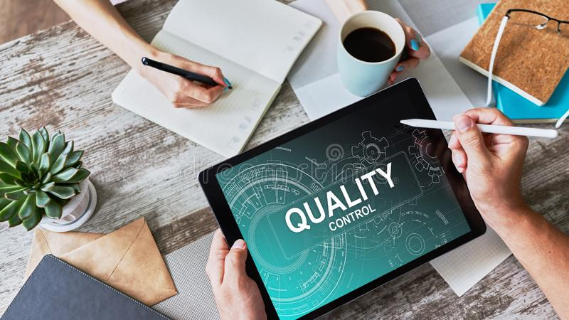 Quality control concept on device screen. Business and technology concept. Quality control concept on device screen. Business and technology concept stock photo