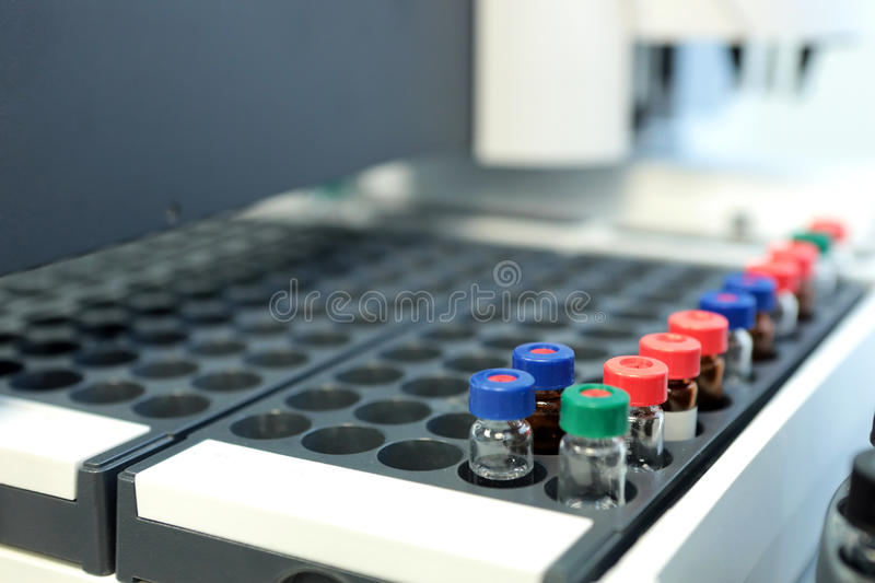 Quality Control Laboratory medicine. Chromatograph operation. Bo. Ttles check on the quality of the suspension. Vials on autosampler of gas chromatography-mass stock photo