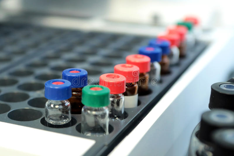 Quality Control Laboratory medicine. Chromatograph operation. Bo. Ttles check on the quality of the suspension. Vials on autosampler of gas chromatography-mass royalty free stock photography