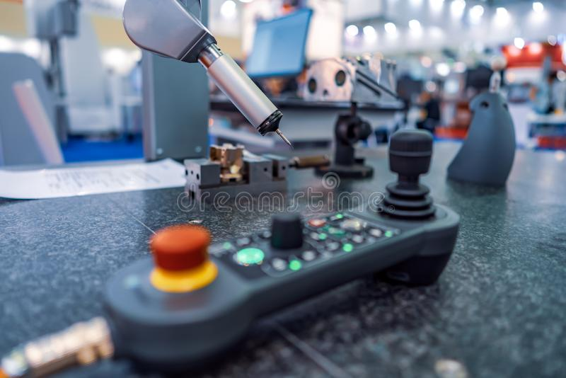 Quality control measurement probe. Metalworking CNC milling mach. Ine. Cutting metal modern processing technology. Small depth of field. Warning - authentic stock images