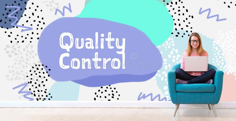 Quality control with woman using a laptop royalty free stock photo