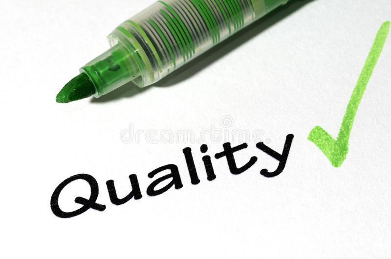 Quality form. The close-up of a pen and white checklist with a checkboxes with words quality