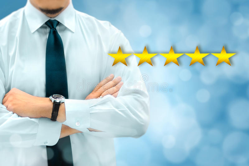 Quality, performance review, evaluation and classification ranking concept. Businessman silhouette in background. Five yellow. Glowing stars icons in the stock image