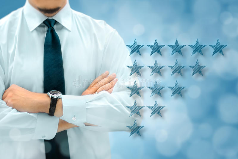 Quality, performance review, evaluation and classification ranking concept. Businessman silhouette in background. Five yellow. Glowing stars icons in the stock photo