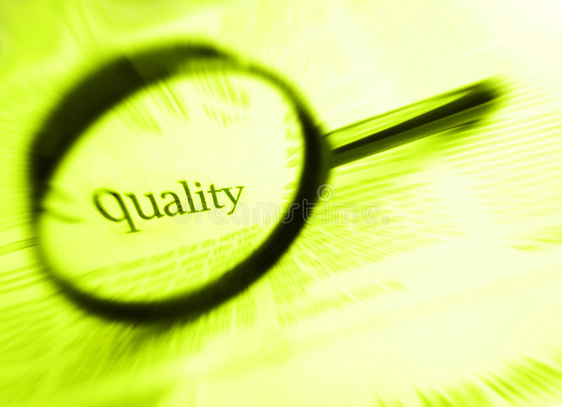 Quality word. A concept image of the word quality focused in a magnifying glass. Simple composition with copy space. monochrome yellow green photo