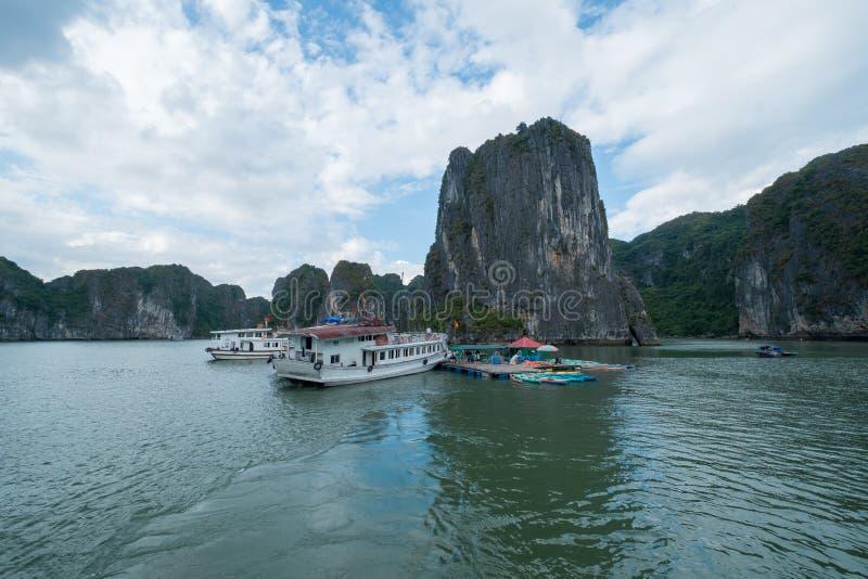 Quang Ninh, Vietnam Nov 12, 2015 Boats and Kayak in Halong Bay stock image