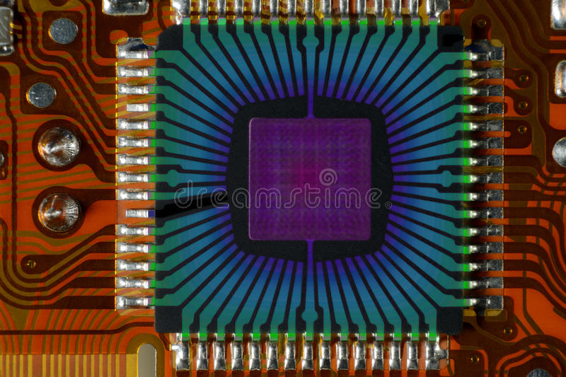 Quantum chip. The quantum chip installed on printed circuit board stock photo