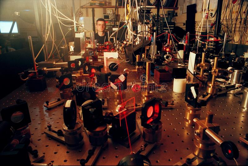 Quantum Computer Research. UK Oxford -- Circa 2000 -- Dr Paul Barton checks the alignment of laser beams used in an experimental quantum computer at the royalty free stock photos