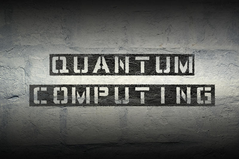 Quantum computing gr. Quantum computing stencil print on the grunge white brick wall stock image