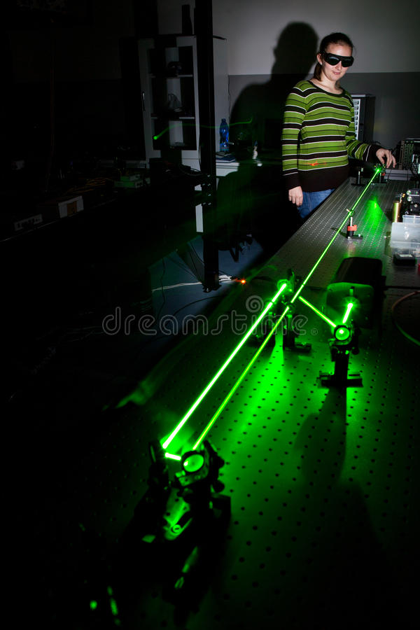 In a quantum optics lab. Female scientist doing research in a quantum optics lab royalty free stock photography