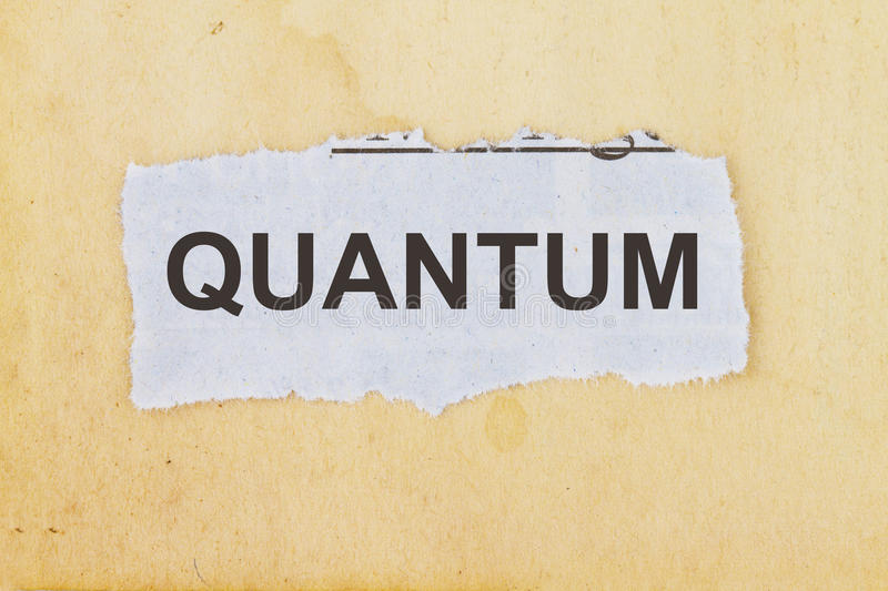 Quantum physics. Quantum newspaper cutout in an old paper background stock photos