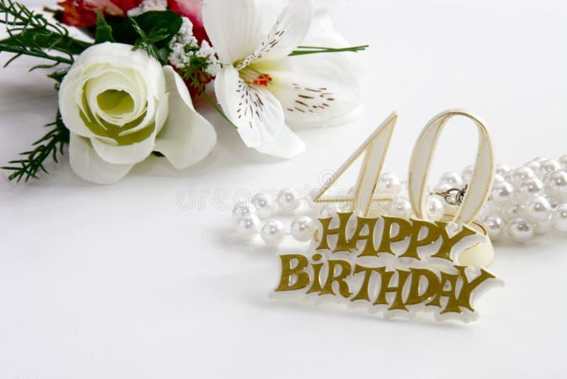 quarantième Le signe d'anniversaire avec les perles et la soie a monté image libre de droits