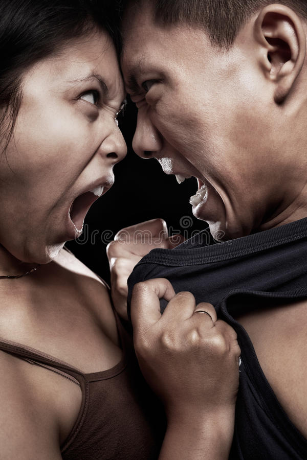 Quarrel. Asian couple having quarrel with physical contact royalty free stock image