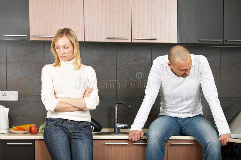 Quarrel. The image of quarrel of a married couple on kitchen