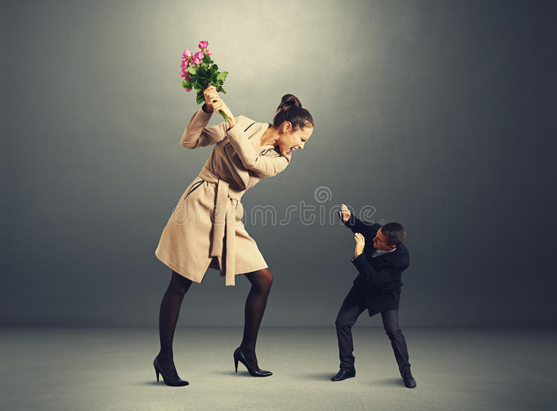 Quarrel between man and woman in dark room royalty free stock photography