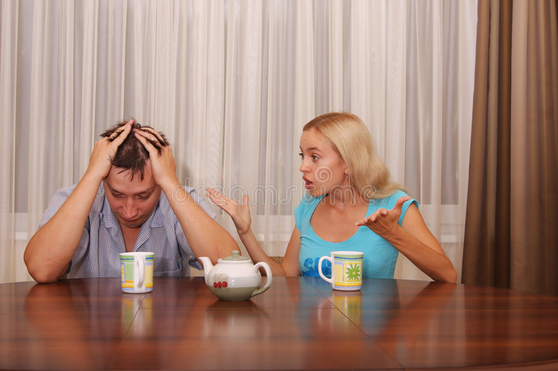 Quarrel between spouses. Wife swears on the husband royalty free stock images