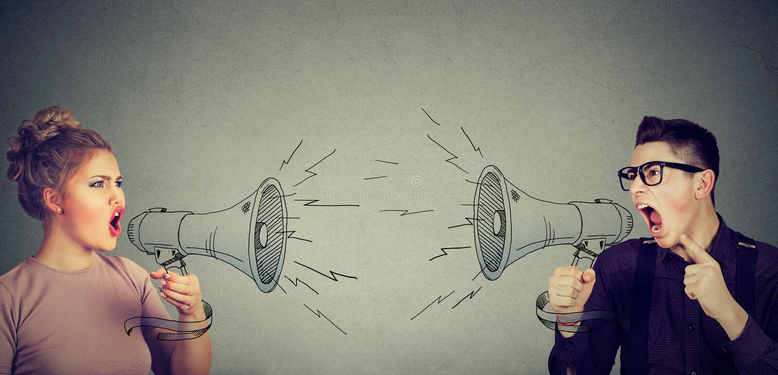 Quarrel between woman and man screaming at each other in megaphone. Quarrel between young women and men screaming at each other in megaphone royalty free stock image
