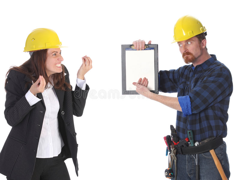 Quarreling. Between angry businesswoman and construction worker wonderfully looking on document royalty free stock image