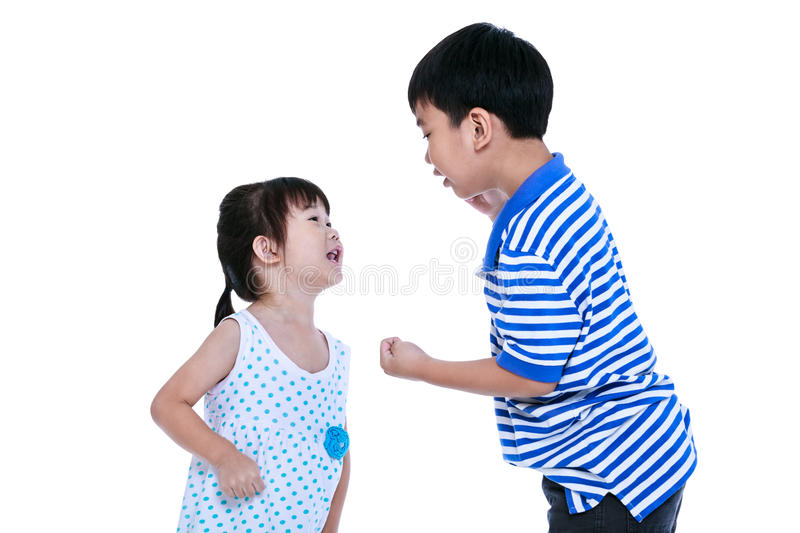 Quarreling conflict between the brother and sister. Isolated on royalty free stock photos