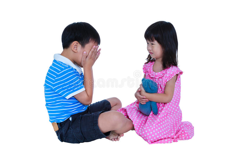 Quarreling conflict of sibling. Concept brawl in family. Isolate. Quarreling conflict of child. Asian boy has problem between sister and crying, sad girl sitting royalty free stock photography