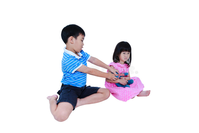 Quarreling conflict of sibling. Concept brawl in family. Isolate. Quarreling conflict of child. Asian girl has problem between brother and crying. Sibling wrest stock images